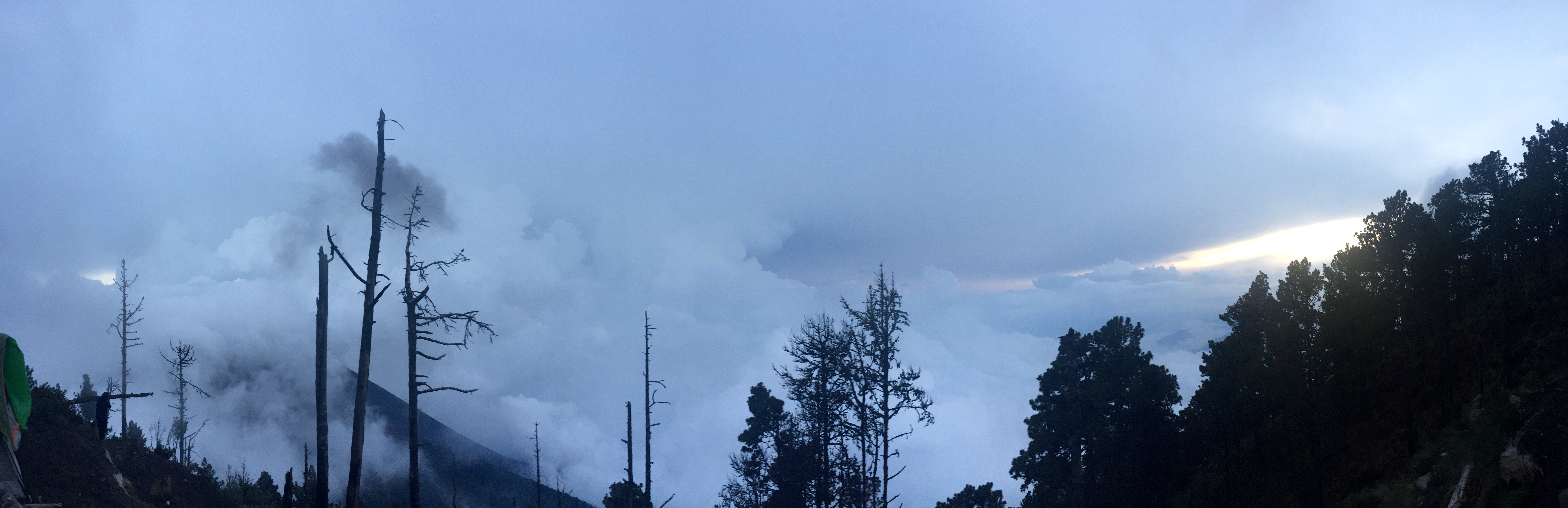 Ash mixed with cloud cover in the evening seen from basecamp.