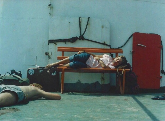 My mother at 26 years old backpacking in Europe with her cousins. She is sleeping here on a ferry boat to the Greek islands.